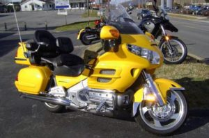 Bright yellow Honda Goldwing GL1800 Touring Motorcycle side view