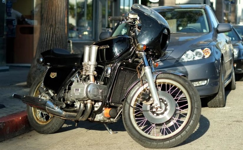 A well worn street fighter Goldwing with a set of Velocity Stacks attached to the carbs.