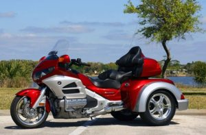 A Honda GL1800 Motorcycle with a motorcycle-trike conversion kit installed.