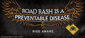 Infographic made to look like an embroidered bikes leather. Road Rash is a Preventable Disease. Ride Aware.