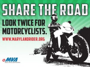 A rider on a sport bike. The text of this infographic reminds motorists to share the road and look twice for motorcyclists.