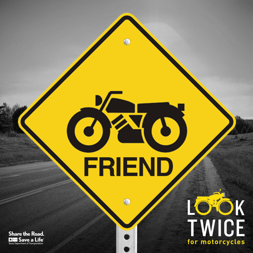 A yellow road sign with a motorcycle and the word Friend. Look twice.