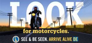Infographic of approaching motorcycle with sunset in background. Text reads - LOOK for Motorcycles. See and Be Seen.