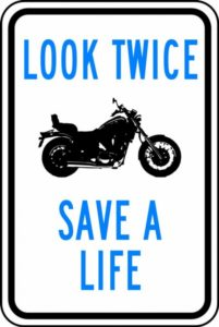 Inforgraphic - Featuring a silhouette of motorcycle. Made to look like a No Parking Sign. Text reads - Look Twice Save a Life.
