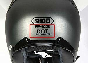 Back of silver motorcycle helmet. DOT certification decal displayed.