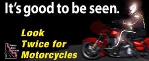 It's good to be seen. Look twice for motorcycles. Motorcyclist riding at night with reflective gear.